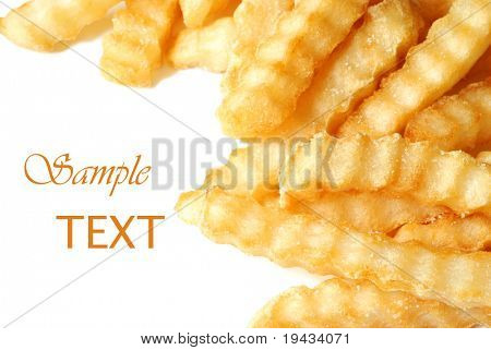 Crinkle cut french fries on white background with copy space.  Macro with shallow dof.