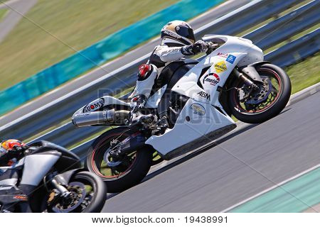 HUNGARORING, HUNGARY - JUNE 19:  Unidentified riders negotiate a corner during ROSBK event at Hungaroring Race Track on June 19,  2009 in Hungaroring, Hungary.
