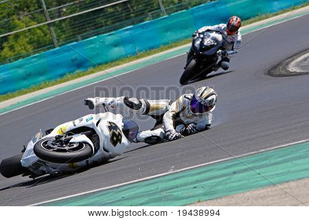 HUNGARORING, HUNGARY - JUNE 19: An unidentified rider crashes at a corner during ROSBK event at Hungaroring Race Track on June 19,  2009 in Hungaroring, Hungary.
