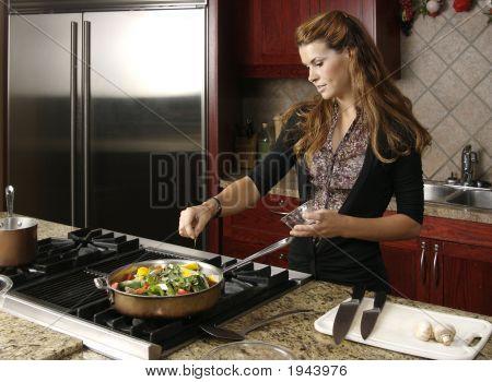 Cooking In Modern Kitchen