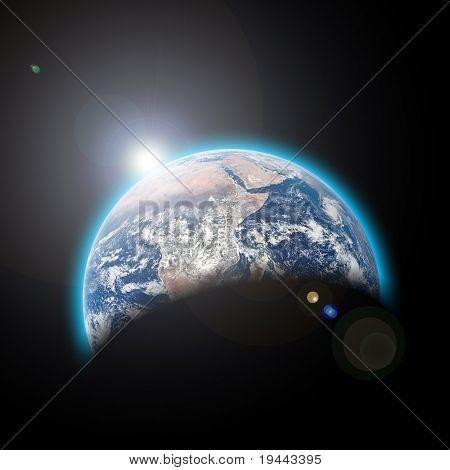 planeta tierra en el espacio con sunrize