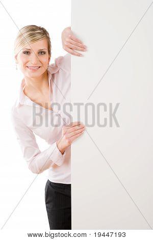 Happy Businesswoman Behind Empty Banner Standing