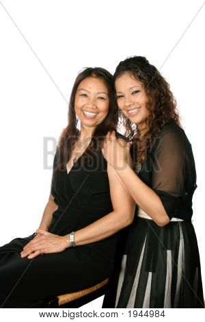 Happy Mature Thai Female With Beautiful Daughter