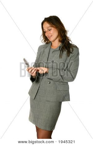 Beautiful Young Businesswoman Keying In Numbers On Her Cellphone