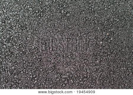 Shiny new warm asphalt abstract texture background