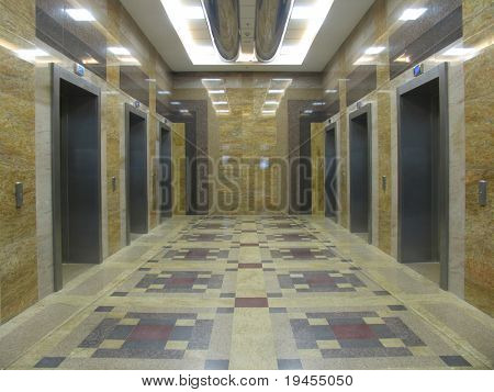 Six lifts in a modern office building