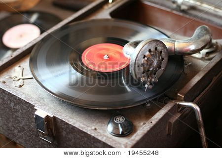 Old vintage gramophone playing vinyl record