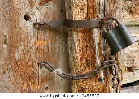 Padlock and chain on an old door