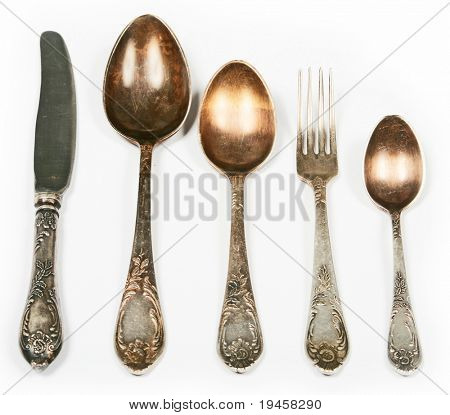 Old spoons, fork and knife isolated