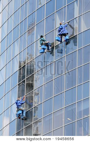 Three window washers on highrise office building