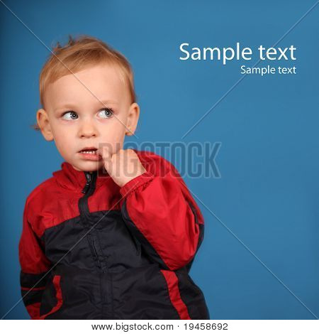 Cute little girl looking at sample text and thinking