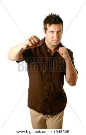 Man In Cool Punching Pose Isolated On White
