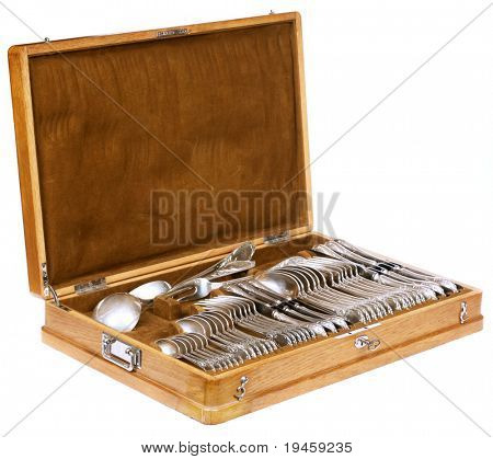 Vintage spoons, forks and knifes in a wooden case isolated