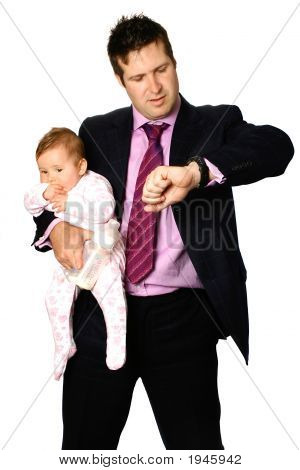 Businessman Looking At Watch While Holding Baby
