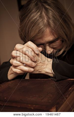Senior Female praying