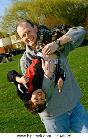 Father And Son Having Fun In Park