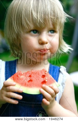 Toddler Girl Enjoying Watermelon