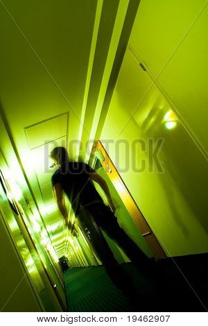 This is the way 2 - Man walking on a long hallway