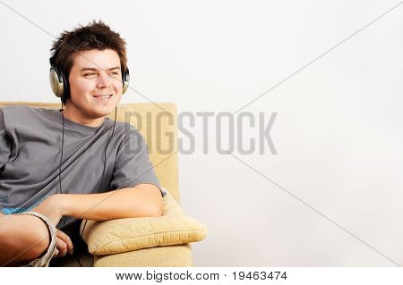 Young Man enjoys listening music in headphones