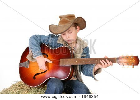 Boy Strumming Guitar