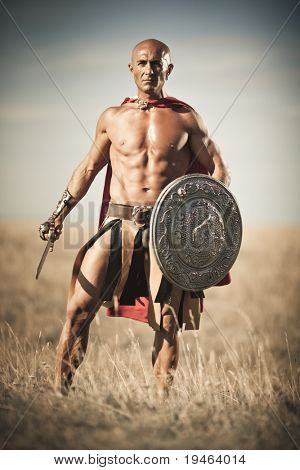 Gladiator, image of a well-built man holding a sword and a shield