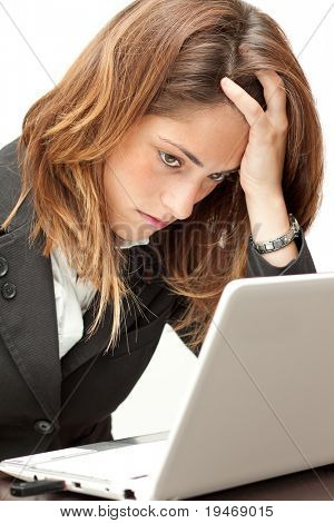 Stressed businesswoman working at her notebook