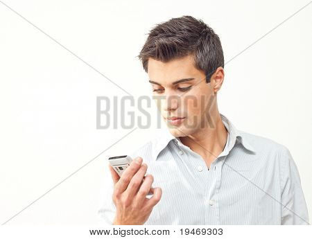 Young man looking at his smartphone