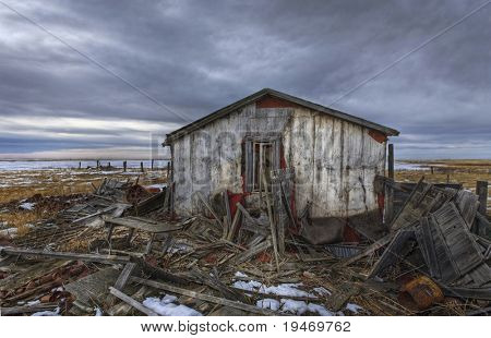 Old abandoned and derelict home on the prairie