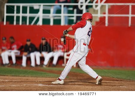 Baseball player makes contact with the ball
