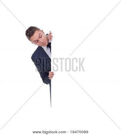 Man Peeking Behind White Billboard