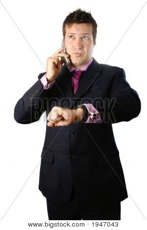 Smart Businessman On Phone With Watch