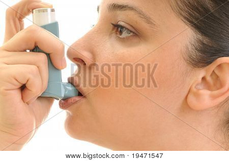 Close up image of an inhaler for asthma in young woman's mouth. White background studio picture