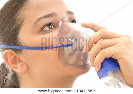 Close up image of a young woman with asthma using oxygen mask. White background studio picture