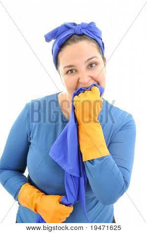 Tired, angry and miserable housekeeper bites cleaning cloth. White background studio picture.