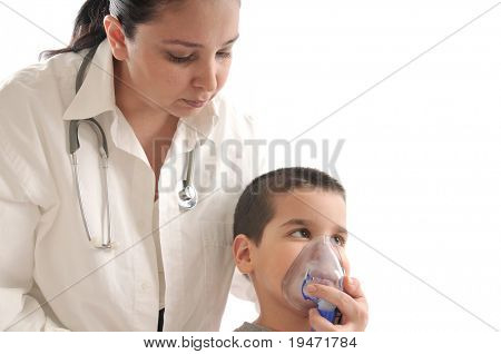 Medical doctor with stethoscope using oxygen mask on her child patient. White background studio picture.