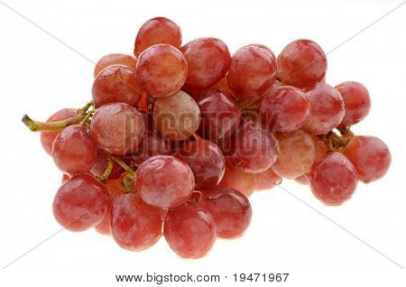 White background high resolution studio image of a pink grape cluster