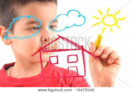 Adorable 6 years old boy painting a house on glass. White background high resolution studio image focused at his hand, face out of focus.
