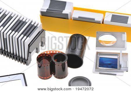 Old timer slide photographer's lightbox including film, loupe, frames and box. White background studio image.