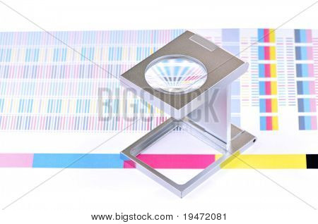 High resolution white background macro studio image of a linen tester and CMYK color sample.