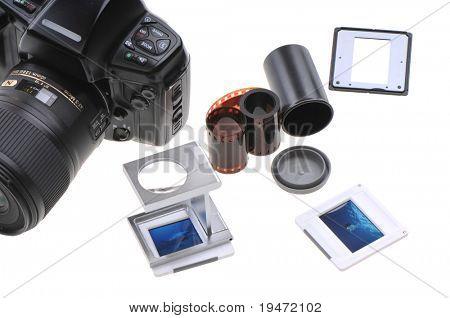 Old timer slide photographer�¢�?�?s lightbox including film, loupe, frames and box. White background studio image.