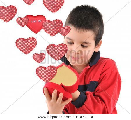 White background, high resolution, studio image of an adorable little boy opening his red heart.