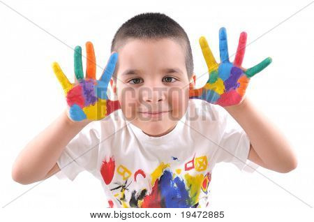 Six year old boy with hands painted in colorful paints ready for hand prints - High resolution, white background, studio image.