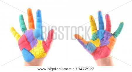Little boy's colorful hands with all fingers up as well as a stop sign. High resolution studio image.