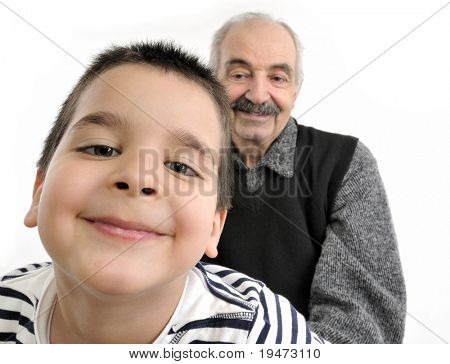 Little cute boy teasing his grandfather
