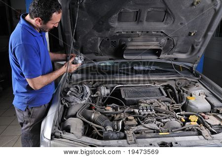 Auto mechanic working on car - a series of MECHANIC related images.