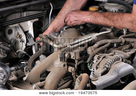 Auto mechanic's hands working on car - a series of MECHANIC related images.