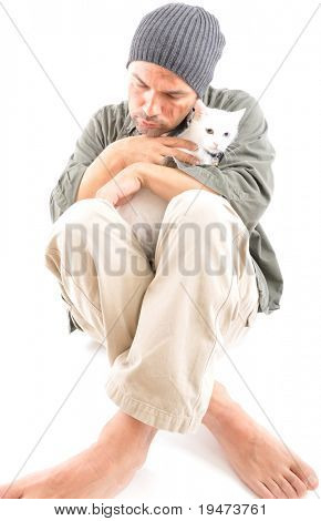 Studio shot of a homeless with his white cat - a series of HOMELESS images.