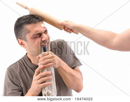Alcololic man beaten up by his wife isolated on white.