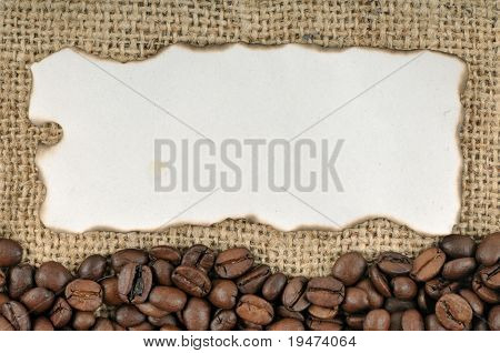 Burned tag on coffee beans and jute background