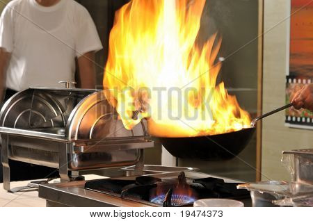 Professional cook preparing food on flame â?? a series of RESTAURANT images.